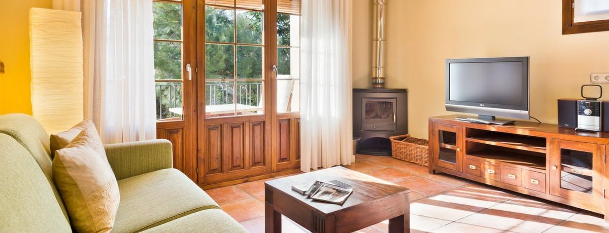 Apartamentos Uncastillo - Salón. Rusticae, Apartamentos rurales en el Prepirineo de Aragón, junto a Sos del Rey Católico.